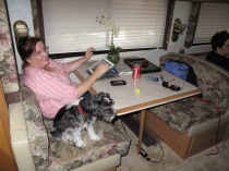 This is the booth dinette. Henry the dog likes the RV lifestyle.